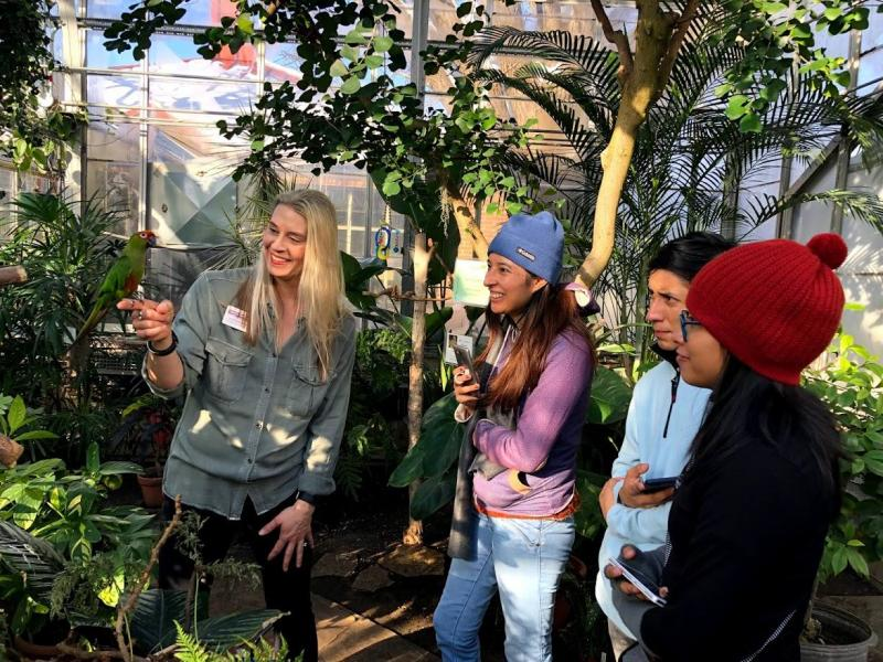 Students exploring the UNI greenhouse